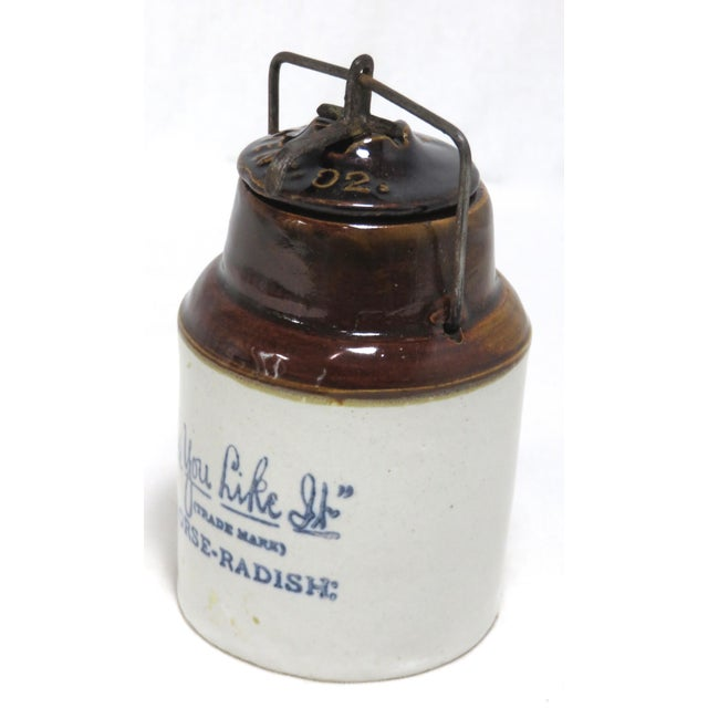 An Small Size Antique American Stoneware Horse Radish Jar. Circa early 1900s. Front has Blue Decorated Lettering that...