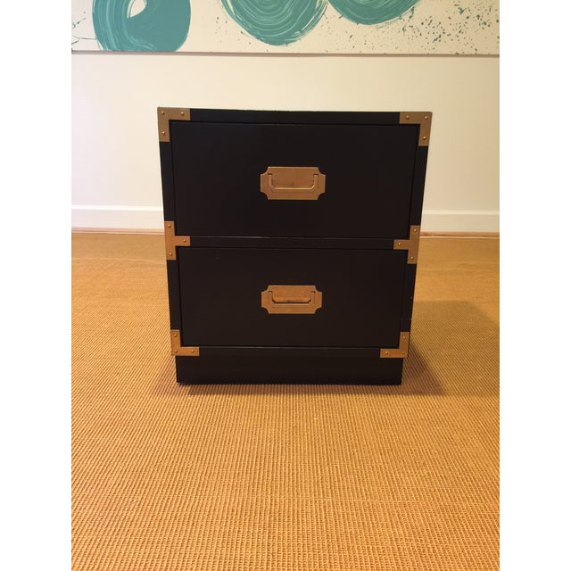 Handsome campaign style nightstand manufactured by Bernhardt. Useful as an accent table, side table or nightstand. Black...
