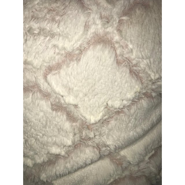 Soft and cozy we are gullible for faux fur pillows with a quatrefoil pattern with a mauve pink background on both sides....