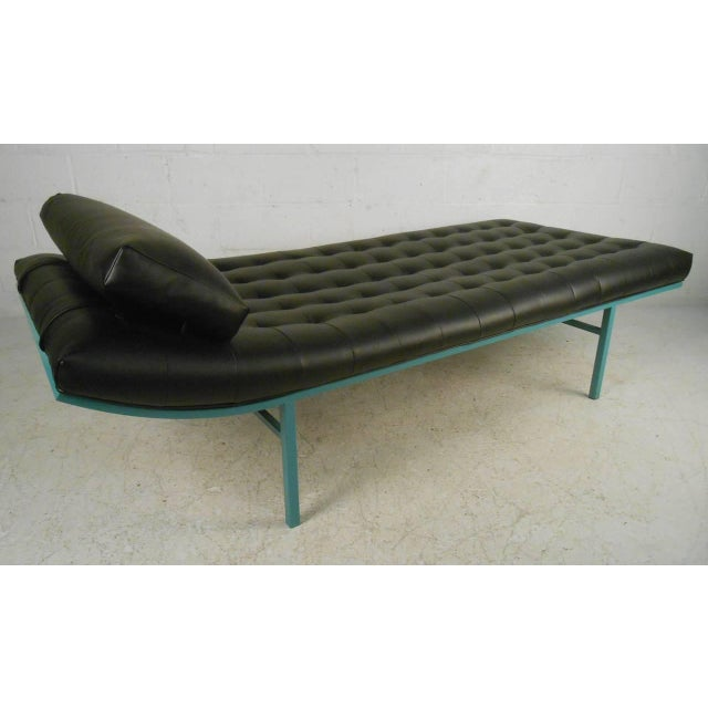 Contemporary modern vinyl tufted chaise lounge with unique teal colored metal frame. The funky retro appeal of this mid-...