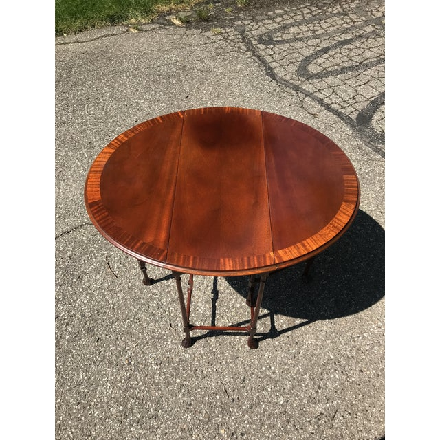 High end side table. Both sides fold up or fold down as desired. Claw feet. Edge banding on top. Glass top fits when both...