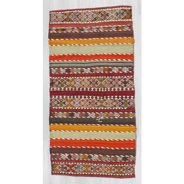 Offered is an antique small kilim rug from Malatya region of Turkey. In good condition. Approximately 60-70 years old.