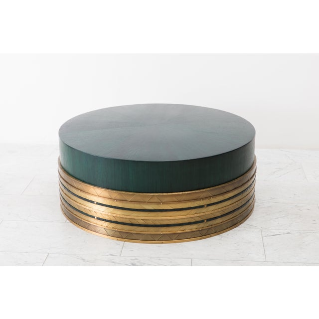 Damian Jones's Nant Table functions perfectly as a coffee table or cocktail table. Its drum shaped form is sheathed in a...