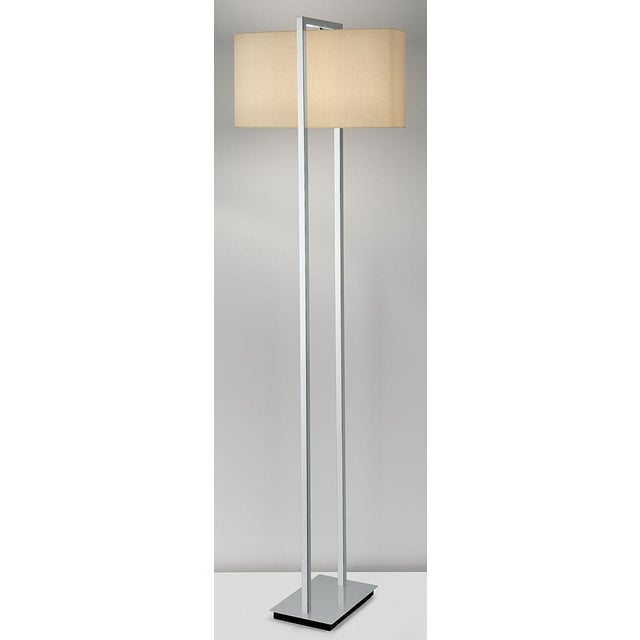 A polished chrome floor lamp with black underbase. Price includes shade. The shade has an integral top diffuser with a...
