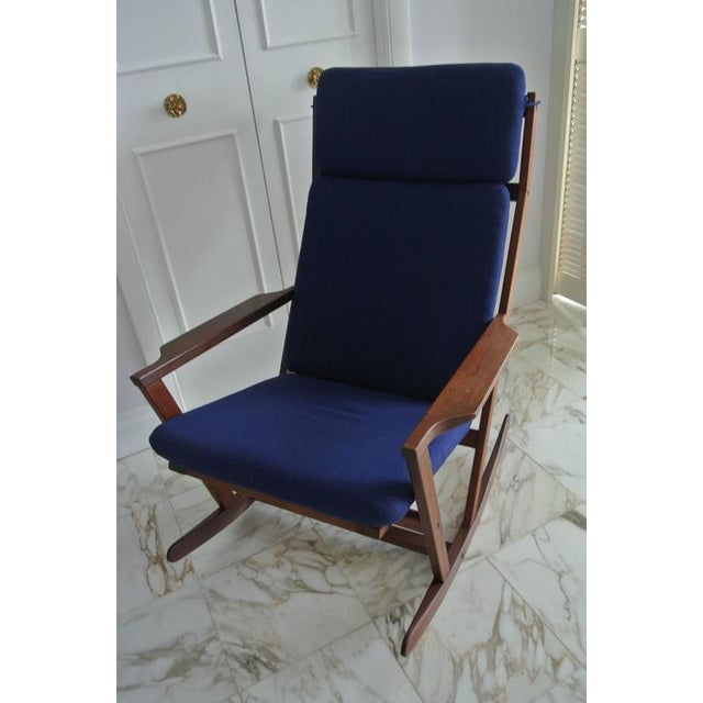 Beautiful teak rocking chair by Poul Volther for Frem Rojle. Original Naugahyde upholstered cushion.