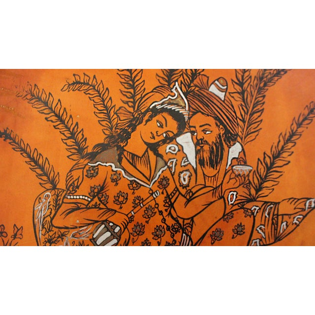 The delicate gaze of lovers is so wonderful in this painting. Painting is on dyed leather with silver accents. An Arabic...