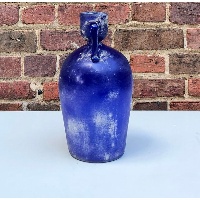 "A large cobalt blue Cenedese vase in the ""Scavo"" technique replicating ancient Roman glass with attached handles."