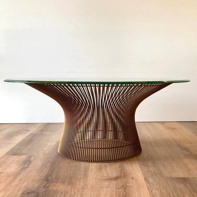 Tempered glass sits atop a sequence of over 100 welded, plated rods to form Platner's classic design. This piece...