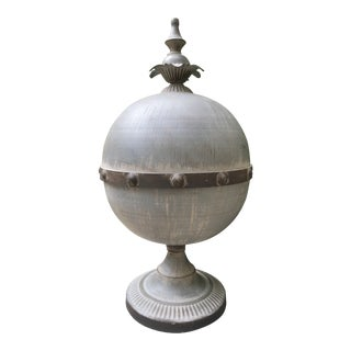 Aged Zinc-Finish Footed Metal Orb With Finial For Sale