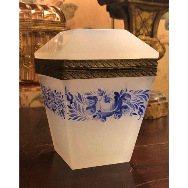 Opaline box with blue flowers and bronze dore fittings in excellent condition from France. Unusual shape with the top...