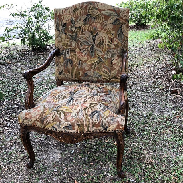 19th Century French Louis XV Tapestry Armchair represents the talents of both a master wood sculptor and a master wool...