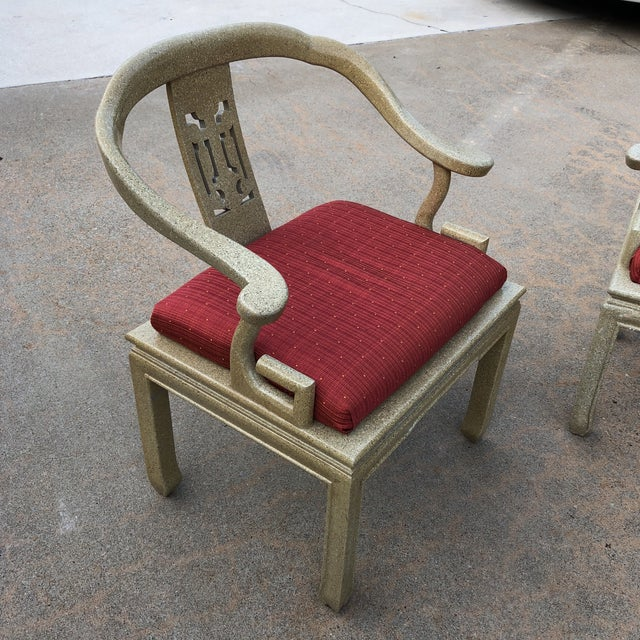 Absolutely gorgeous pair of rare Greek key wooden chairs with speckled vintage details.