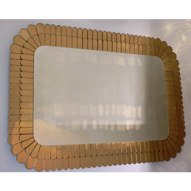 Elegant sculpture mirror of rectangular shape, entirely handcrafted in Italy, highest quality of construction and...