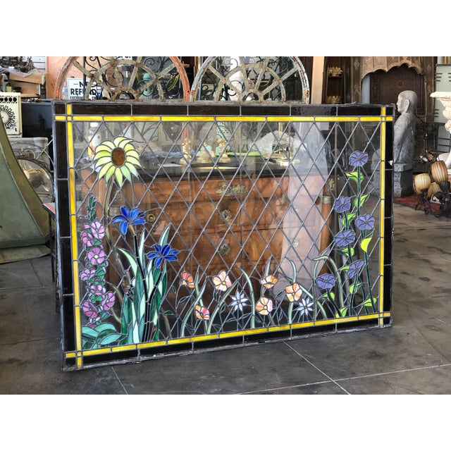 This is an amazing stained glass window put together with leaded glass and beautiful colored flowers. It has such...