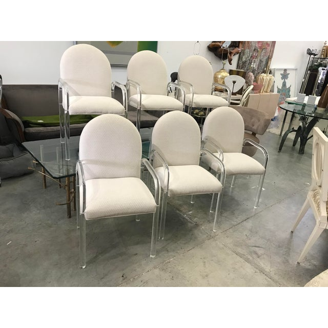 Six 1970s lucite dining chairs in good vintage condition. Please keep in mind these chairs are almost fifty years old in...