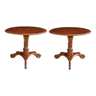 A handsome and warmly-patinated pair of Swedish Biedermeier style circular tilt-top tripod pedestal tables