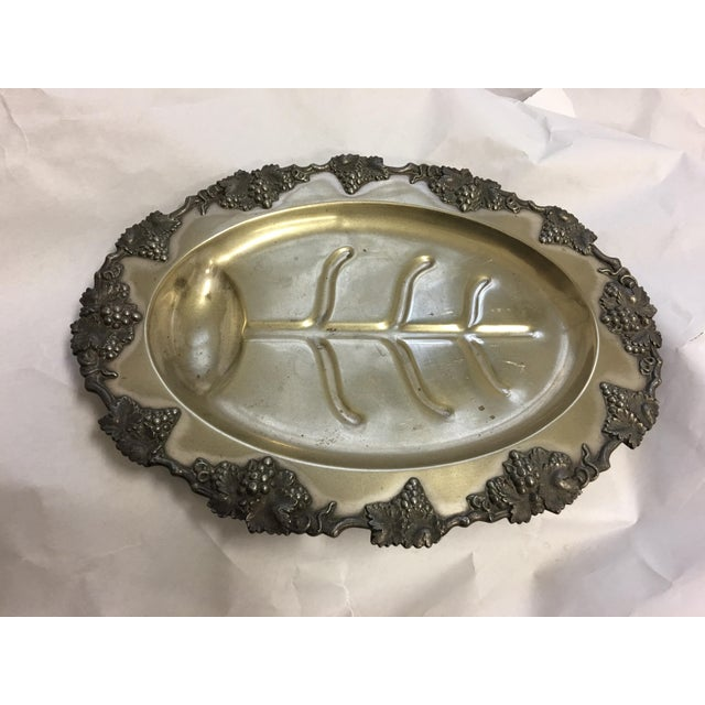 A very nice ornate fish serving platter with grape decor at edges. A wonderful piece.