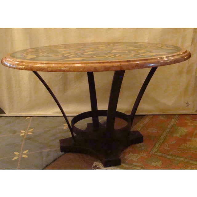 A beautiful Pietra Dura inlaid specimen marble table with iron base. Perfect for a foyer!