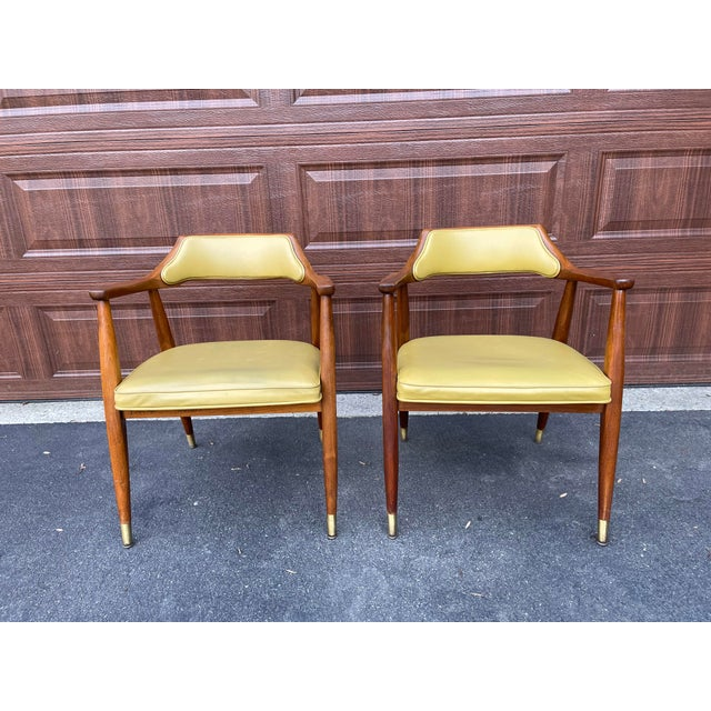 Pair of Jasper Chair Company accent chairs. Walnut arm chairs with marigold naugahyde upholstery. Sturdy and comfortable....