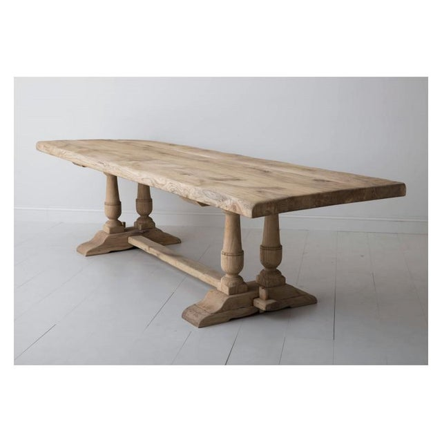 A grand-scale, sturdy French oak trestle dining table, circa 1880, with a soft, honey-colored bleached patina. This table...