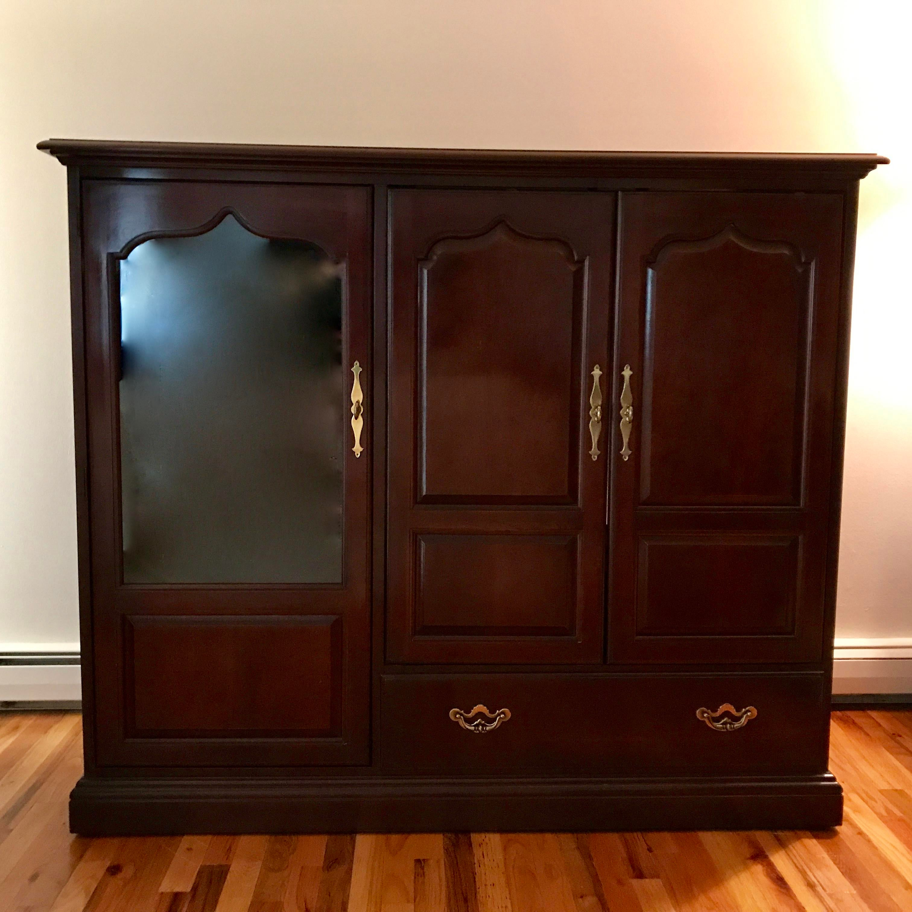Traditional Style Entertainment Cabinet With Double Doors Which Fold Back  Into The Cabinet For Easy