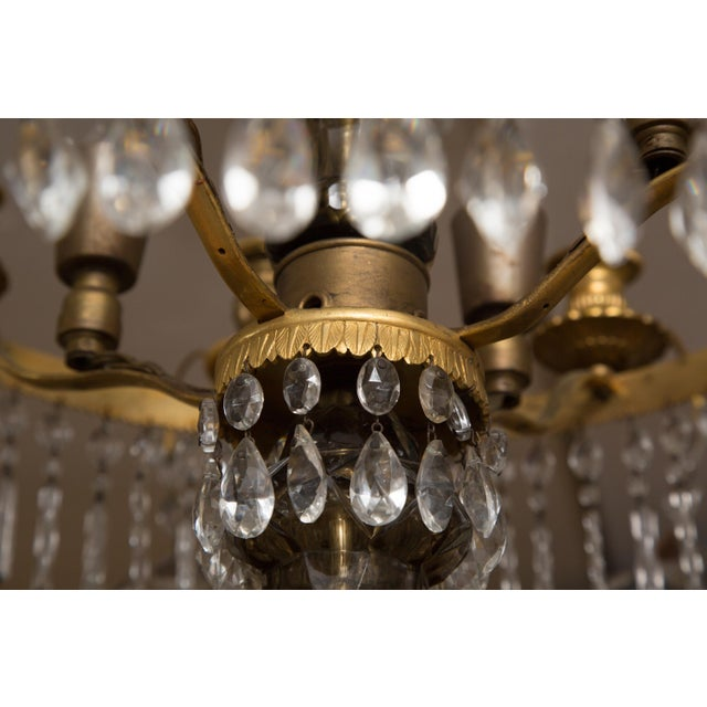 This is a charming Baltic gilt metal chandelier with three graduated concentric circles of waterfall-form strings of...