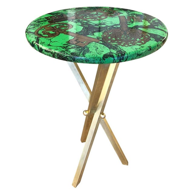 """Chiavi"" side table by Piero Fornasetti depicting ancient keys on a green marble background. Brass tripod base. Original..."