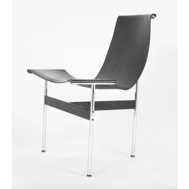 A set of 6 black leather and polished chrome T dining chairs designed by Douglas Kelly, Ross Littell and William...