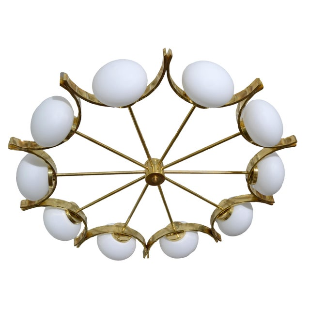 Stunning one of a kind Italian modern round brass chandelier with ten opaline glass globes. The brass frame is hammered...