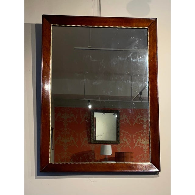 Large wall antique mahogany and gold rope trim mirror. The mirror has an original antique plate.