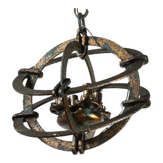 1960s Italian Cast and Hammered Iron Chandelier For Sale