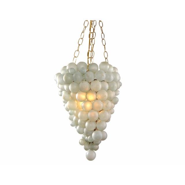 Large Italian Mid-Century Modern Blown Murano Glass Balls in Grape Shape Chandelier. The different Glass Balls are mounted...
