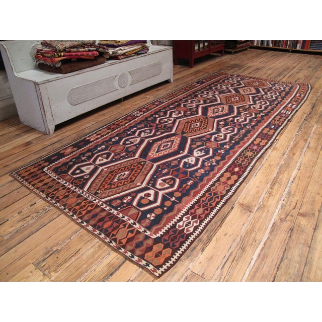 Beautiful Kurdish kilim from Eastern Turkey, with a warm color palette, enhanced by the use of natural brown wool.
