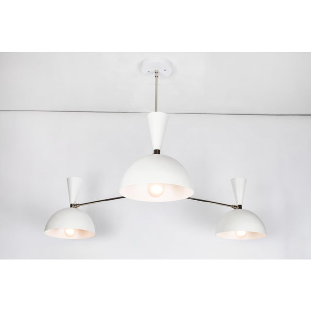 Large three-cone 'Lola II' chandelier in white and chrome. Hand-fabricated by Los Angeles based designer and lighting...