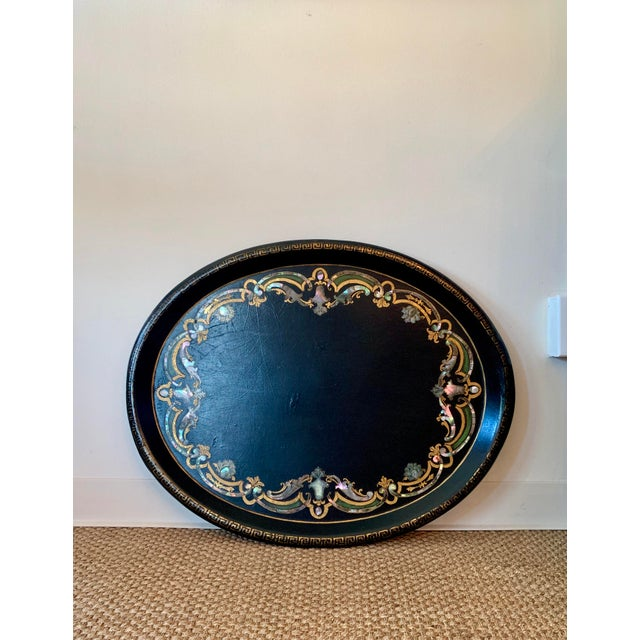 Fabulous black Papier Mache Victorian Tray with Mother of Pearl Inlay. Great statement piece on an ottoman or hanging on a...