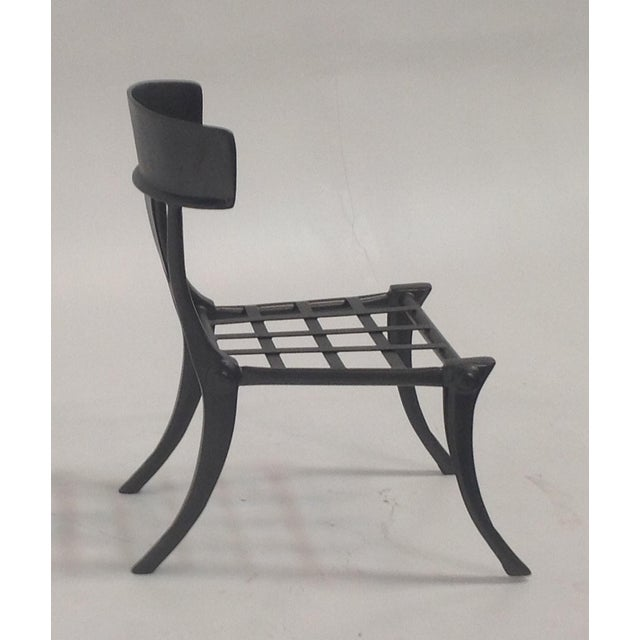 Klismos style outdoor dining chair. Chair is matte grey. Chair is made of iron and solid. Chair is part of a set of 8. I'm...