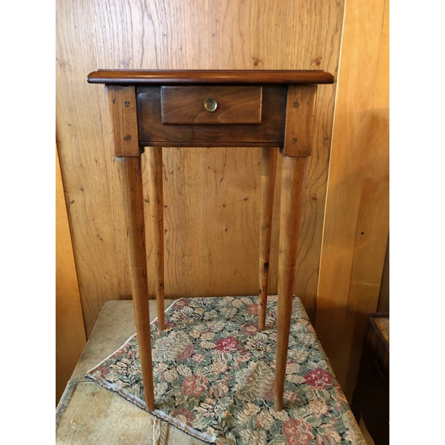 A family piece brought over from France and circa 1800 (possible very late 18th Century). One drawer, petite nightstand or...