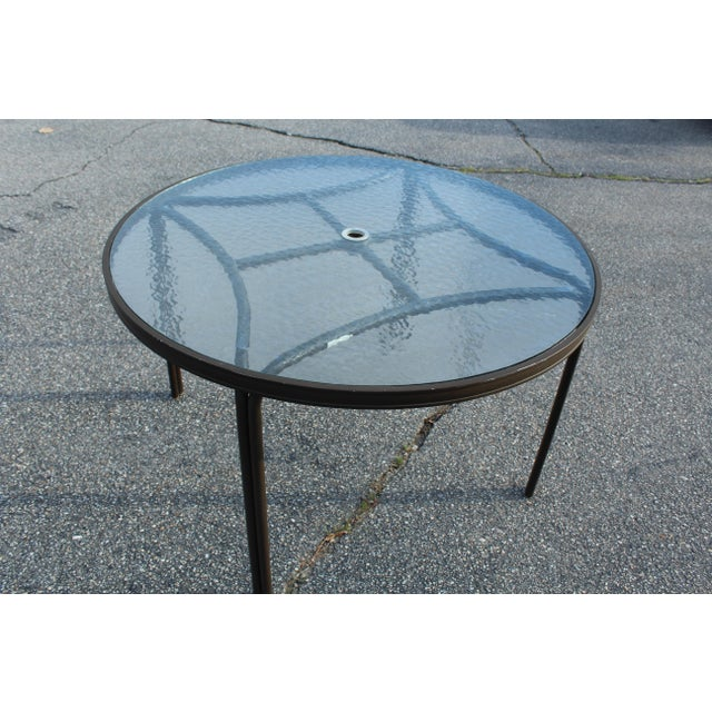 Brown Jordan aluminum luxury outdoor table with round glass top. Chairs sold separately, can seat up to 4.