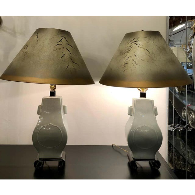 Porcelain crackle glaze table lamps. Chinese inspired pair of mint green table lamps each with a custom shade. The pair...