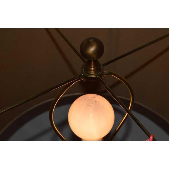 An beautiful brass disc lamp with an elegant brown shade, a wonderful addition to any space!