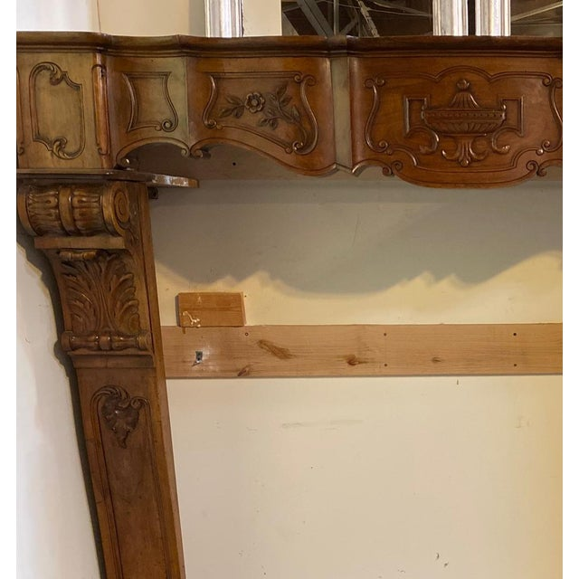 Antique wood mantel. This handsome mantel is sure to be a crowd pleaser and great topic of conversation. Origin: France,...