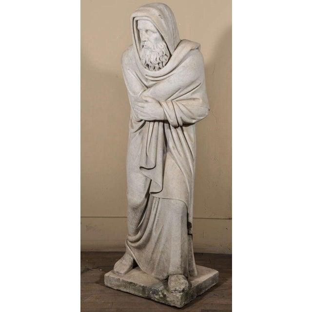 Italian Carrara marble statue; a figural representation of the season winter, marked INVERNO at its base.