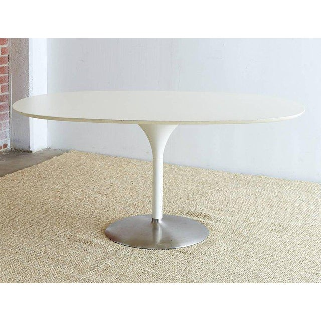 Stunning contemporary oval dining table featuring a tulip shaped base made in the manner and style of Eero Saarinen...