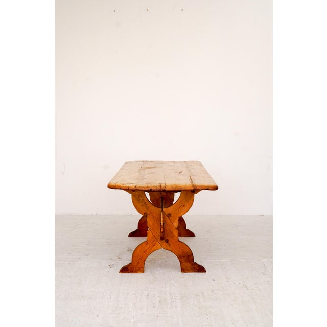 A 19th century antique pine table. Heavy patina from years of use and worn to perfection. Wood joinery and solid...