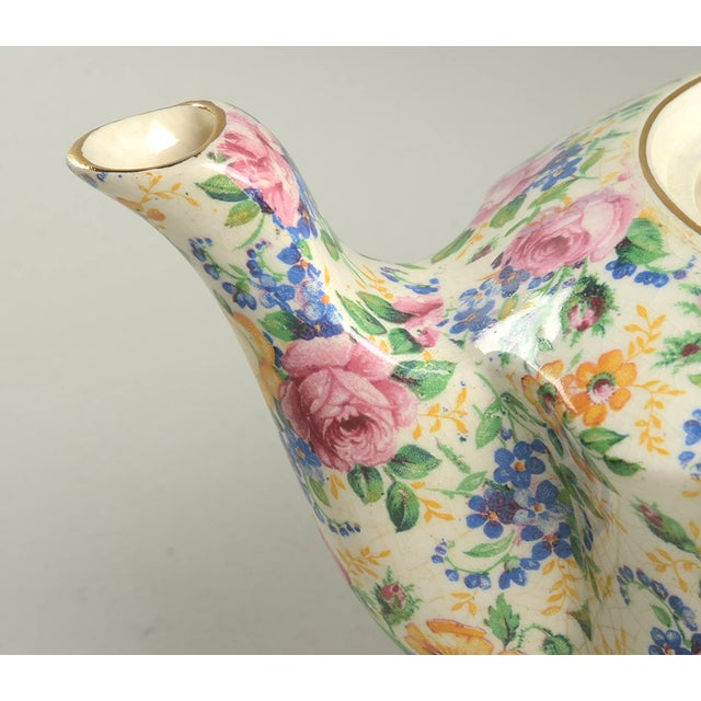 James Kent Rosalynde Chintz 4 Cup Teapot & Lid features an allover floral pink, blue, and yellow floral chintz design....