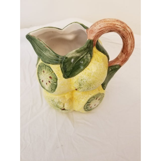 Charming Italian hand-painted lemon motif pitcher. Perfect for your summer table. Made in Basesno, Italy. Pitcher is...