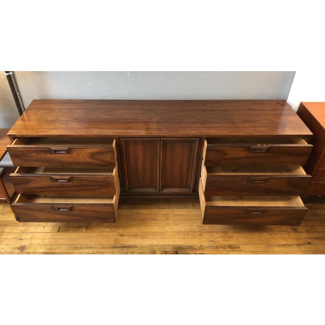 Well made 9 Drawer Credenza style Dresser made in the USA in the 1960s. Walnut exteriors, ash interiors. Lots of storage....