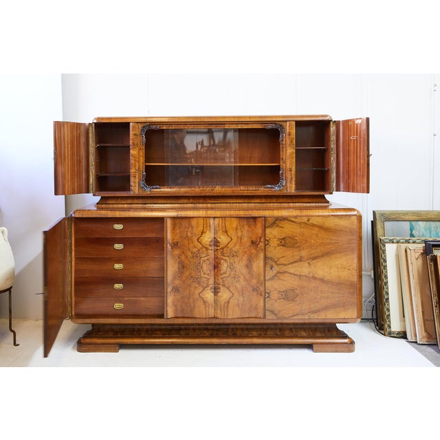 Early 20th Century German Art Deco period buffet with upper bar cabinet. An upper bar cabinet features a display behind...