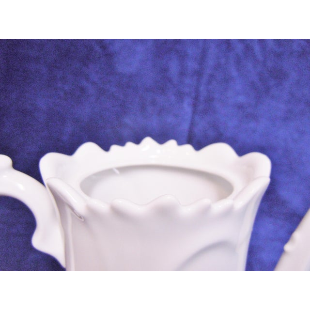 "Teapot elegant white porcelain Condition is like new. Measures approximately 8 ¼"" tall and 8"" from tip of spout to end of..."