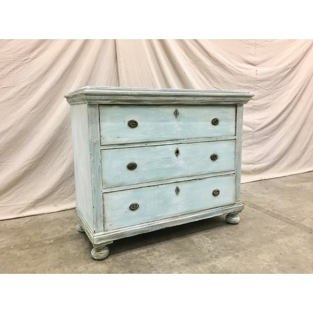 Beautiful 18th C French commode, made of oak, with original hardware, and distressed painted patina. This lovely three...